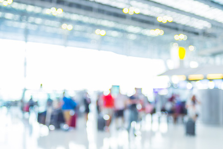 commuters: Blur background of Terminal Departure Check-in at airport with bokeh. Stock Photo