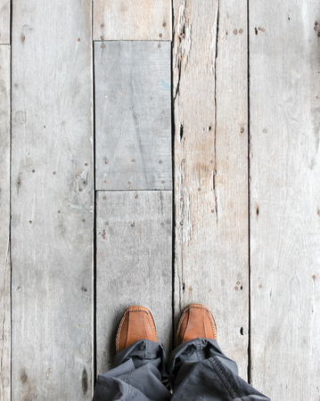 top angle view: Leather shoes on wooden plank floors