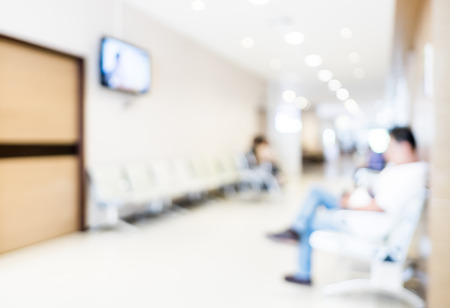 hospital interior: Blurred patient waiting in hospital Stock Photo