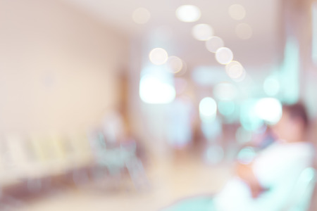 hospital care: Blurred patient waiting in hospital Stock Photo
