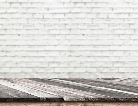 counter top: Empty Diagonal Wooden Table top at blurred white brick wall Stock Photo