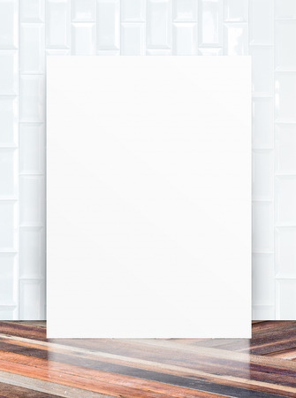 White Blank Poster in ceramic tile wall and diagonal wooden floor room photo