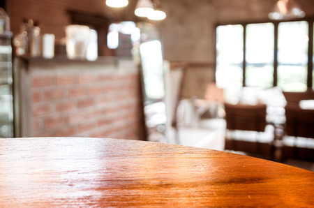 sitting at table: Empty round table top at coffee shop blurred background with bokeh light