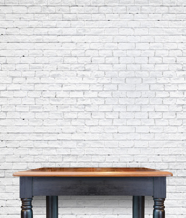tile wall: vintage wood table at brick tiles wall,Template mock up for display product