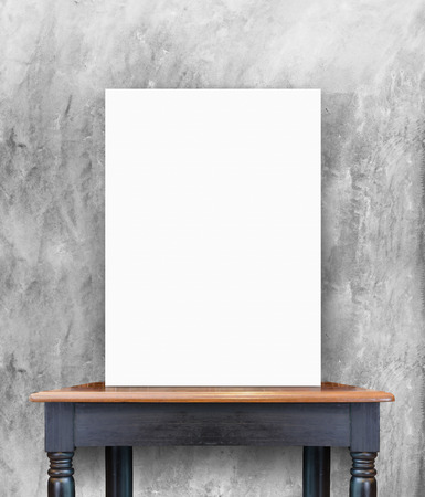 grunge: blank poster on vintage wooden table at concrete wall,Template for add your content Stock Photo