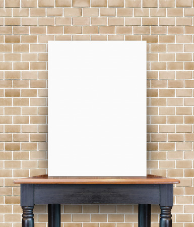 blank poster on vintage wooden table at brick tiles wall,Template for add your content photo