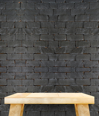 modern wood table at brick tiles wall,Template mock up for display product photo