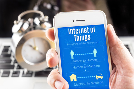 mobile internet: Close up Two hand holding smartphone with Internet of things word and icons, Connectivity concept. Stock Photo