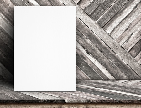 Black White paper poster lean at tropical wood wall and tropical wood table,Template mock up for adding your text. photo