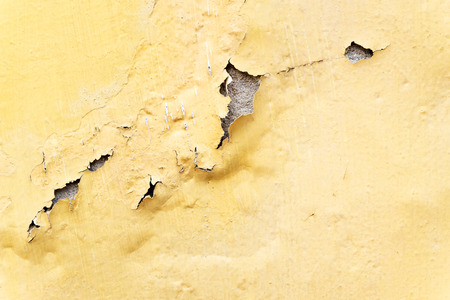 erode: yellow erode painted concrete wall,grunge rough texture background