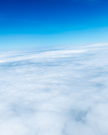 Blue sky and Cloud Top view from airplane window,Nature background. photo