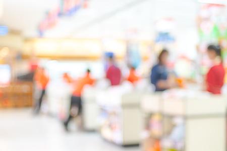 Supermarket store blur background ,Cashier counter with customer.