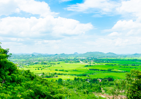 country side: Top view Landscape of green meadow with blue sky and mountain at country side Thailand.