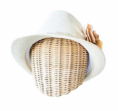 mannequin head: lady hat on a wickerwork mannequin head isolated on white background.