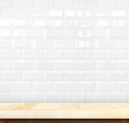 bathroom wall: empty wood table top with white ceramic tiles wall,Product display template.
