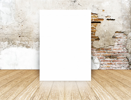 White Blank Poster in crack brick wall and concrete floor room,Template Mock up for your content. photo