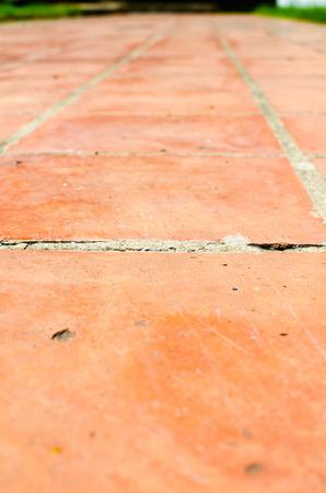concrete background: Perspective background : orange brick floor.