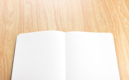 blank open notebook on wood table,Business template mock up for adding your text. photo