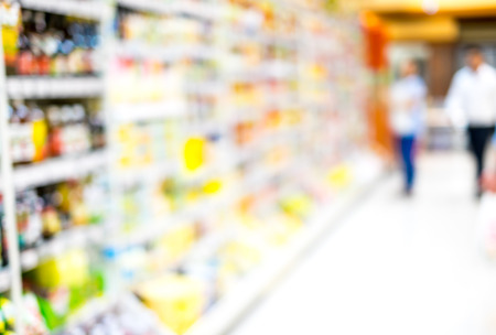 Supermarket store blurred background with bokeh,defocused light in store. photo