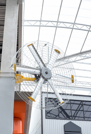departmentstore: Big fan on post at departmentstore in summer time.