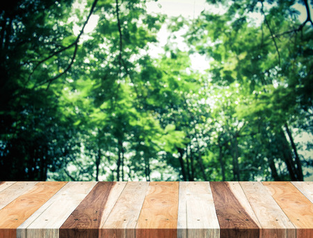 wood table perspective Empty perspective tropical wood table with blurred  green tree forest,Template