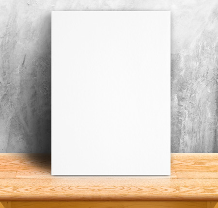 presentaion: Black White paper poster lean at concrete wall and wood table,Template mock up for adding your text. Stock Photo