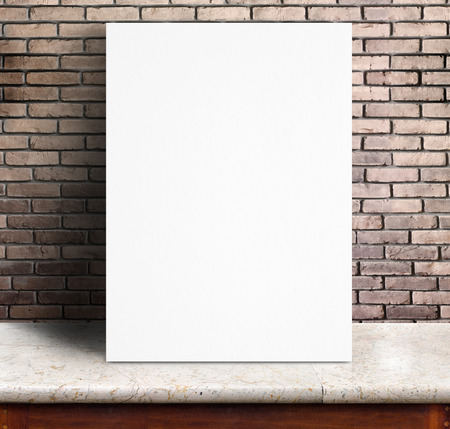 Black White paper poster lean at red brick wall and marble table,Template mock up for adding your text. photo