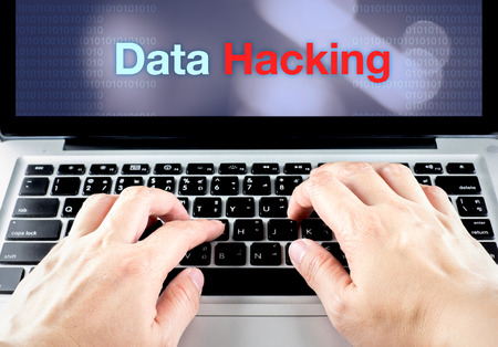 hand type on laptop with data hacking on screen with blur background, internet security concept. photo
