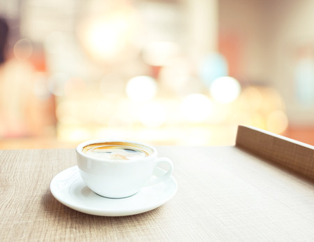Espresso Coffee cup on wood table in cafe with bokeh light background, Leisure lifestyle concept