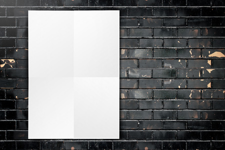 Black White paper poster hanging at grunge black brick wall,Template mock up for adding your text photo