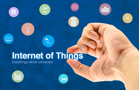 object: Hand holding Internet of things (IoT) word and object icon and blur background, Networking concept
