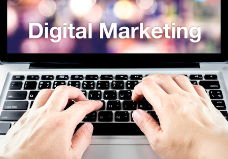 hand type on laptop with Digital Marketing word with blur background, Digital Marketing concept. photo