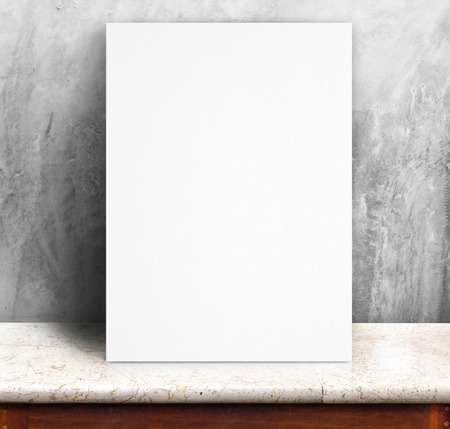 Black White paper poster lean at concrete wall and marble table,Template mock up for adding your text. photo