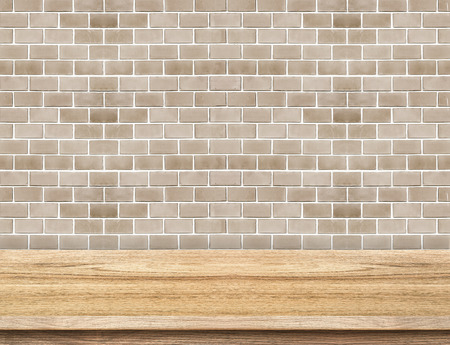 Empty wood table and red brick wall in background. product display template photo