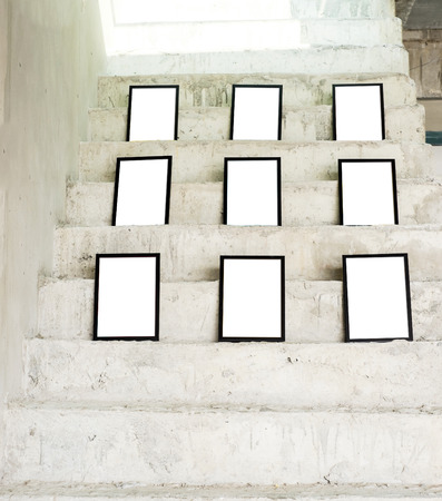 up stair: Group of black photo frames on rough concrete stair at building,Template mock up for adding your picture.