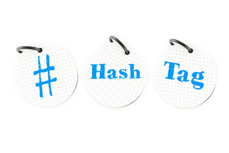 the social network: Hand writing # hashtag word on circle paper note pad on white background, Social media trend concept. Stock Photo