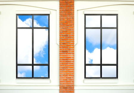 nice house: house window with brick post and reflection of nice blue sky.