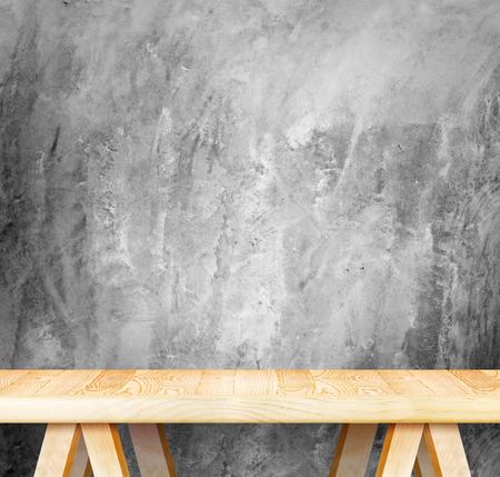 Empty wood modern table and grunge concrete wall in background,Mock up template for display of your product. Stock Photo