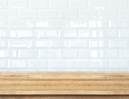 Empty wood table and  white ceramic tile brick wall in background,Mock up template for display of your product.