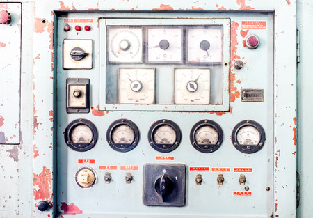 Close up Rustic control panel of old machine,grunge object. photo
