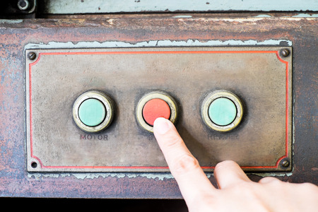 meter box: Finger press rustic control panel of old machine,grunge object. Stock Photo