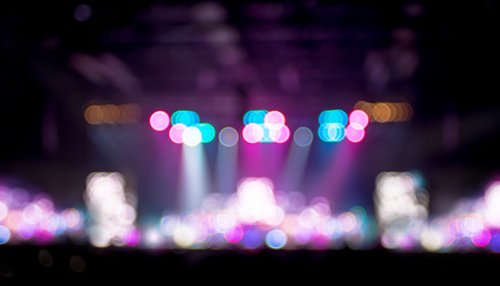disco backdrop: Blurred background : Bokeh lighting in concert with audience ,Music showbiz concept.