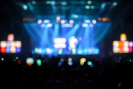 nightclub crowd: Blurred background : Bokeh lighting in concert with audience ,Music showbiz concept.