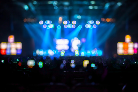 live performance: Blurred background : Bokeh lighting in concert with audience ,Music showbiz concept.
