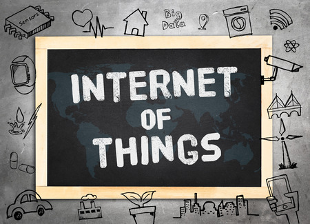 relate: Blackboard on concrete wall  with doodle icon relate with Internet of Things (IOT) , Technology concept