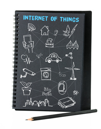 relate: Open black notebook on white background with doodle icon relate with Internet of Things (IOT) , Technology concept Stock Photo