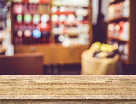 shelf: Empty wood table and blurred restaurant background. product display template.Business presentation. Stock Photo
