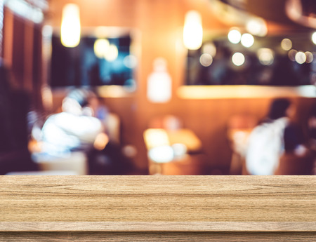 cafe shop: Empty wood table and blurred restaurant background. product display template.Business presentation. Stock Photo