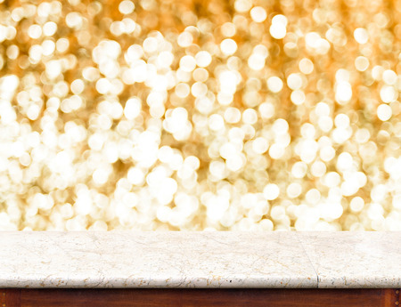christmas display: marble Table with bokeh golden sparkling background,Empty room for display your product.
