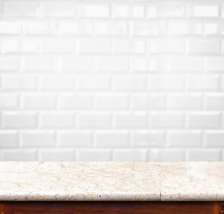 shinny: Empty marble table and ceramic tile brick wall in background. product display template